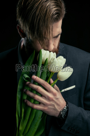 stylish, businessman, in, suit, holding, tulips - 20508591