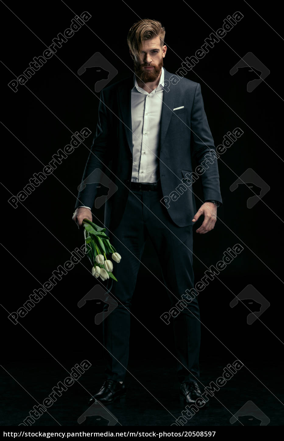 stylish, man, in, suit, holding, tulips - 20508597