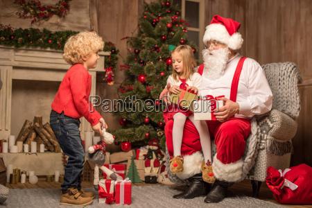 santa claus with happy children