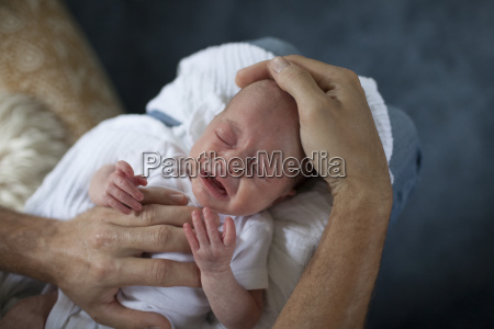 a father comforts and consoles his