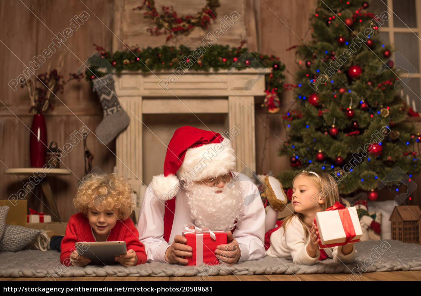 santa, claus, and, children, lying, on - 20509681