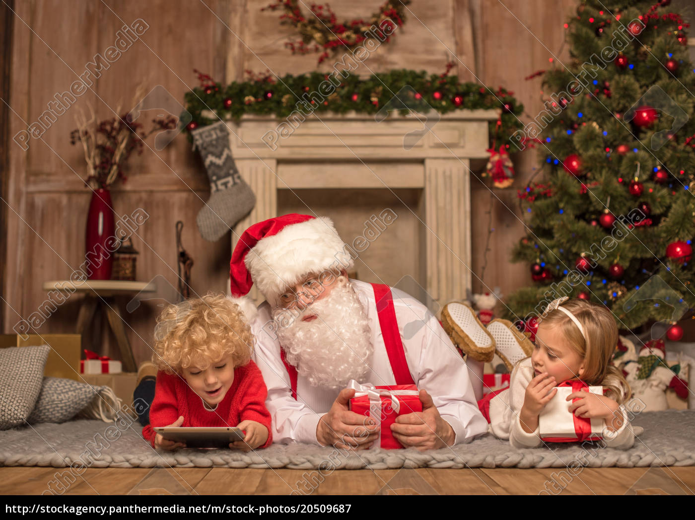 santa, claus, and, children, lying, on - 20509687