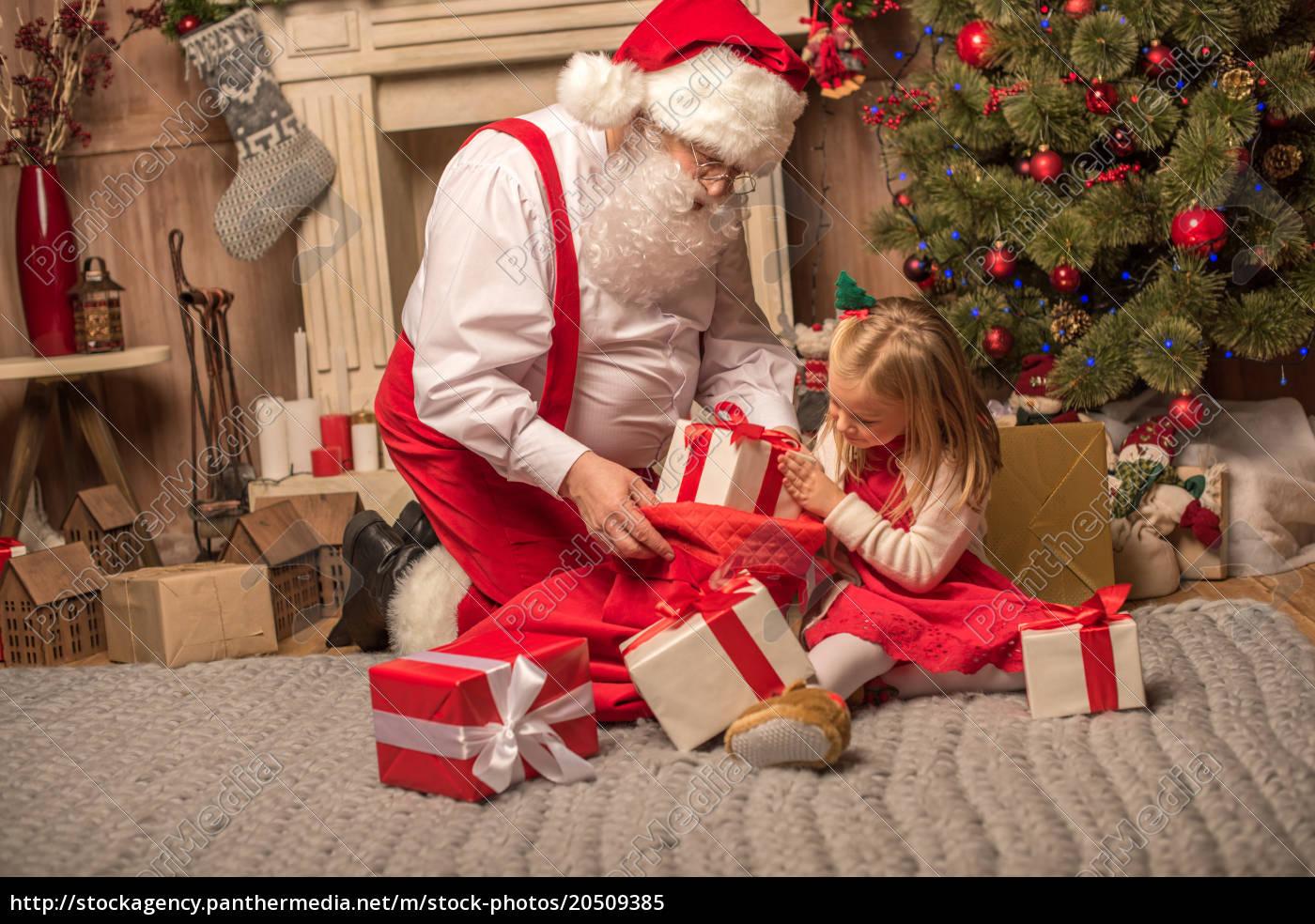 santa, claus, showing, christmas, presents - 20509385