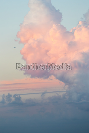 fluffy pink clouds with a light