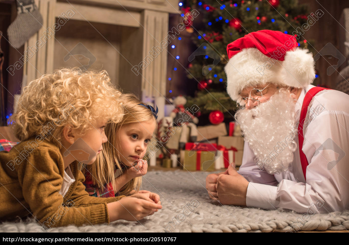 children, and, santa, claus, lying, on - 20510767