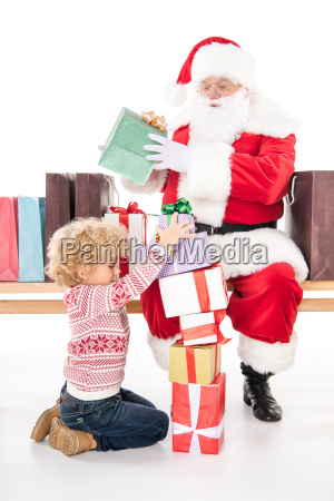 santa claus with child and gift