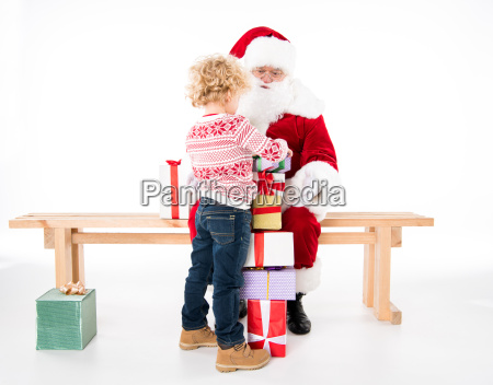 santa claus with kid and gift