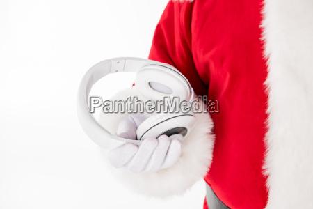 santa, claus, hand, showing, headphones - 20511863