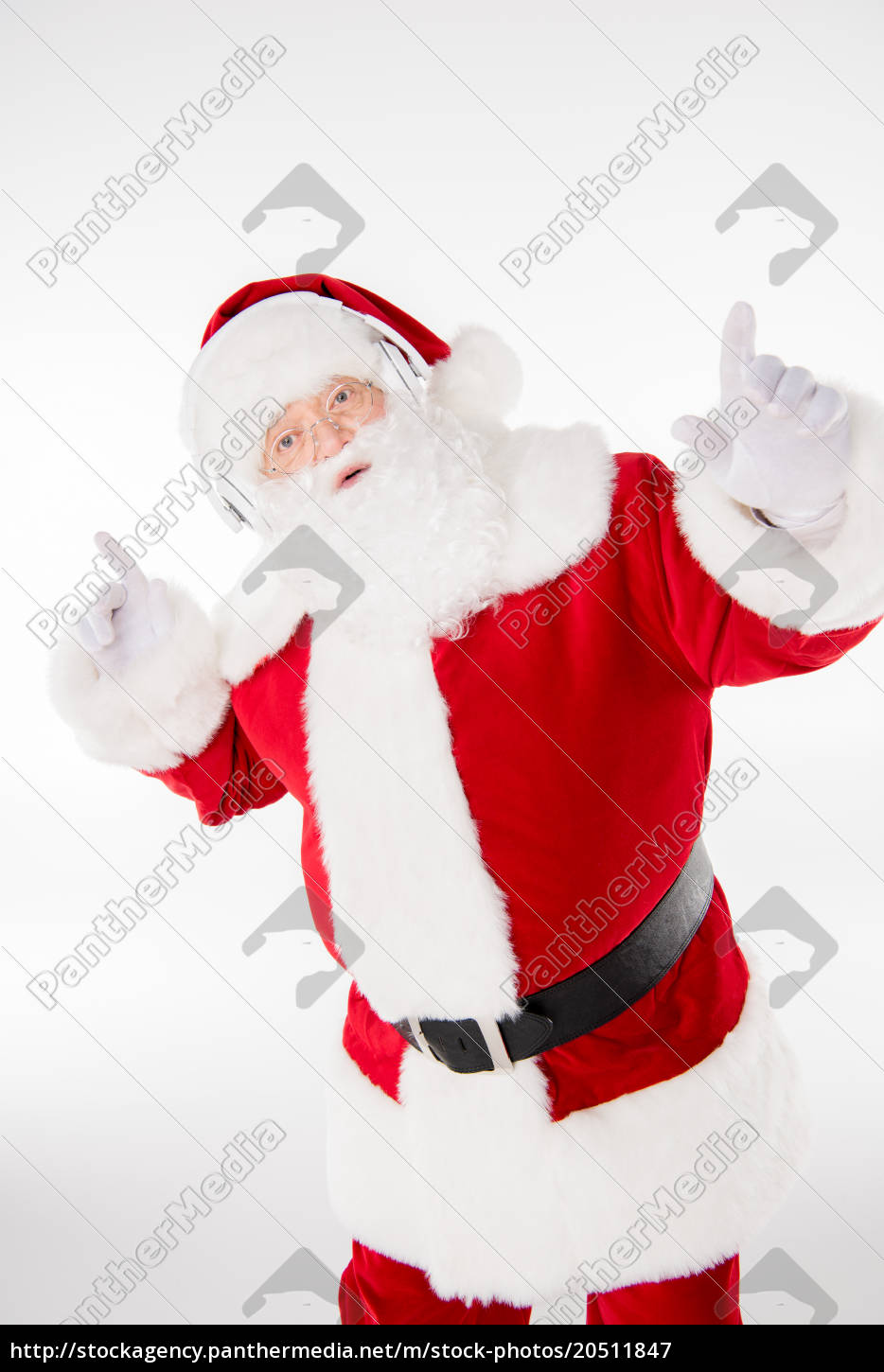 santa, claus, listening, music, with, headphones - 20511847