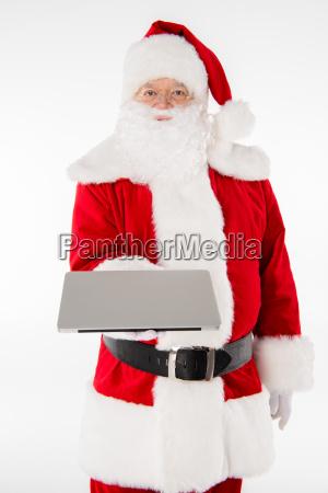 santa, claus, showing, laptop - 20511879