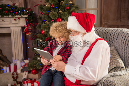 santa, claus, with, kid, using, tablet - 20511629