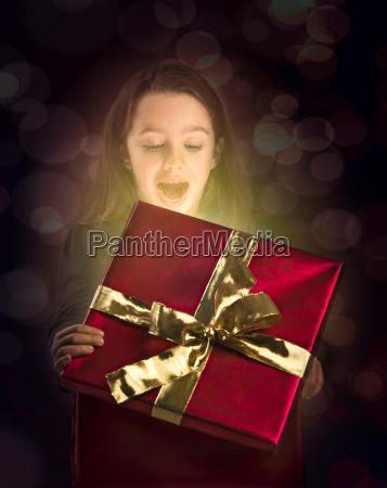 little, girl, opening, a, magic, box - 20512847