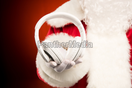 santa, claus, hand, showing, headphones - 20512271