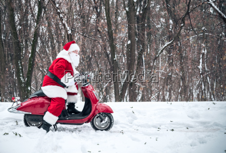 santa, claus, riding, on, scooter - 20512537