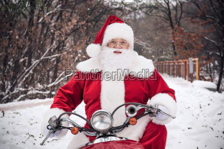 santa, claus, riding, on, scooter - 20512551