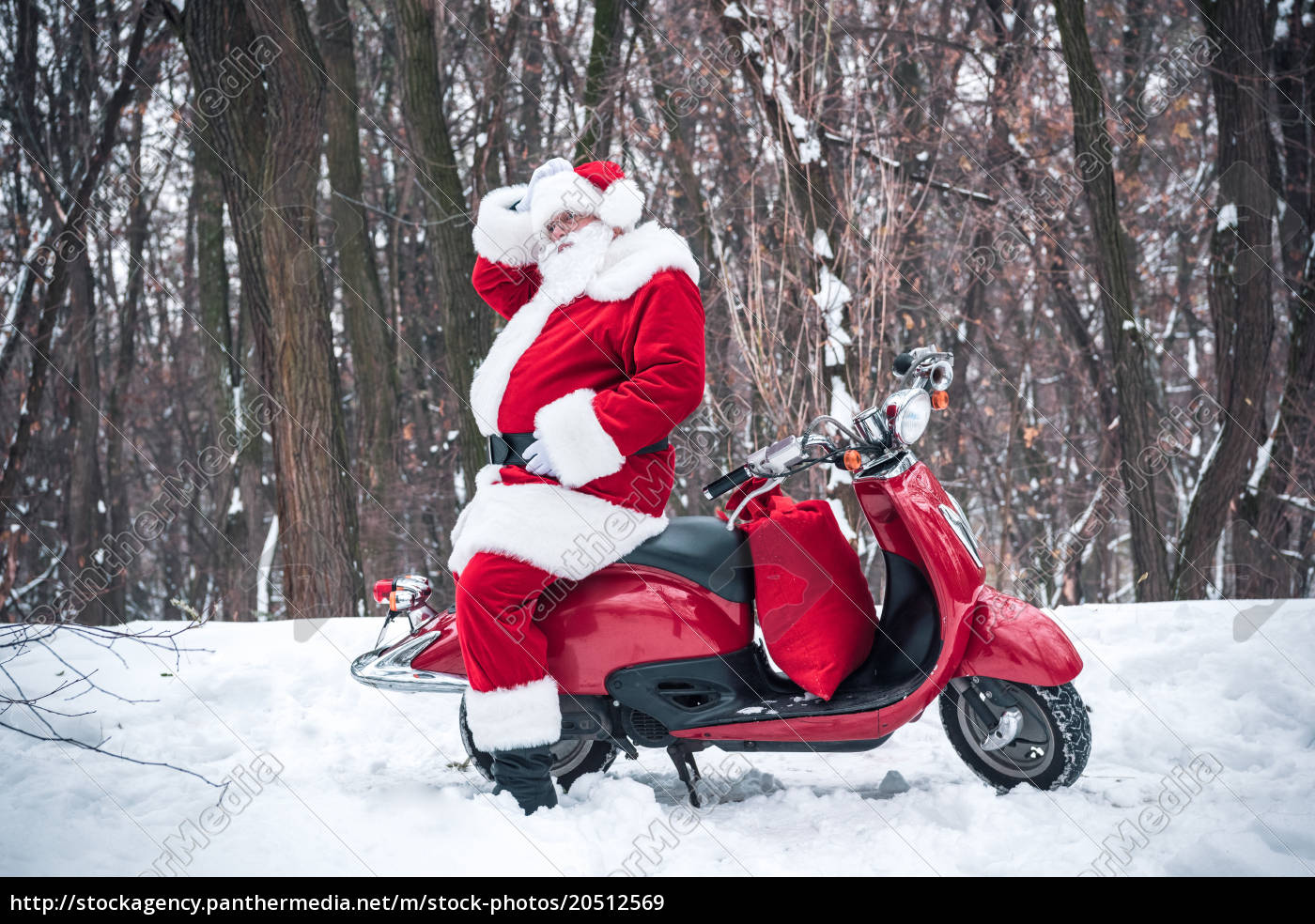 santa, claus, sitting, on, red, scooter - 20512569