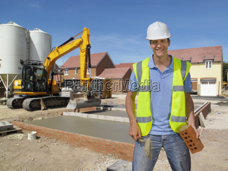 portrait of bricklayer working on construction