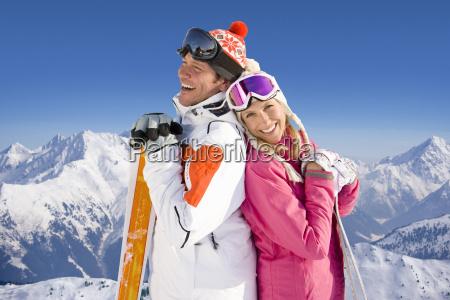 couple enjoying winter ski holiday in