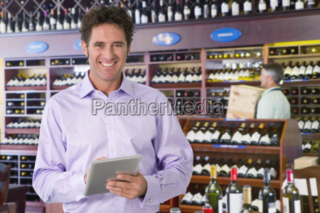 portrait of wine store owner with