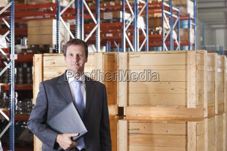 portrait of businessman in warehouse despatch