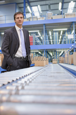 portrait of businessman in warehouse despatch