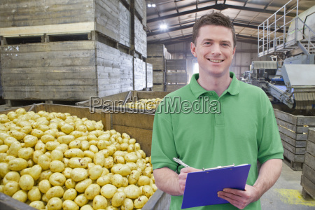 portrait of worker in potato processing
