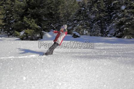 girl falls in sparkling powder snow