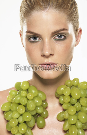 portrait of woman wearing grapes
