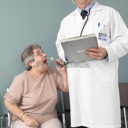 woman screaming into doctors stethoscope