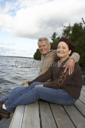 portrait of couple on dock
