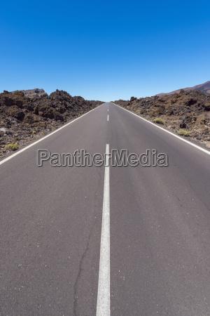 road through lava field in parque