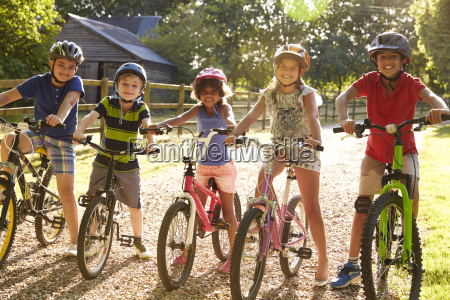 portrait of five children on cycle