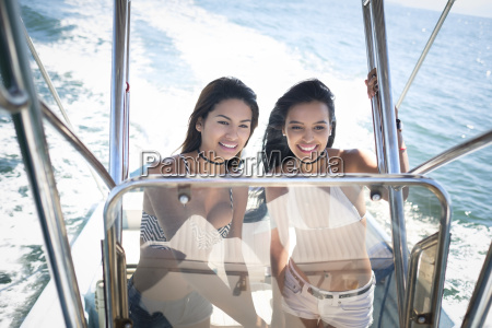 two young women on a boat