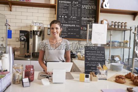 woman waiting behind the counter at