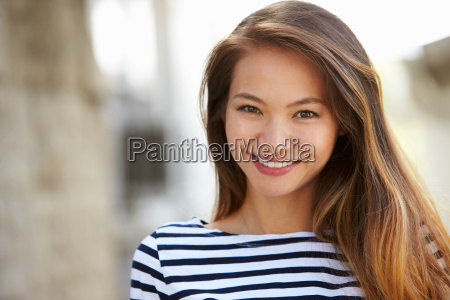 outdoor portrait of attractive young woman
