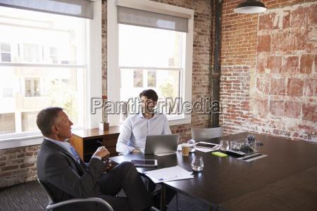 businessmen having creative brainstorming meeting in