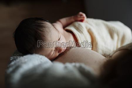 mother breastfeeding her newborn baby