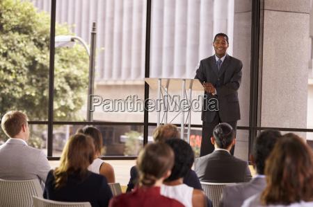 black businessman presenting seminar smiling to