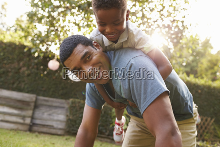 young black boy playing on dads