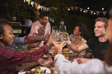 friends and family toasting at garden