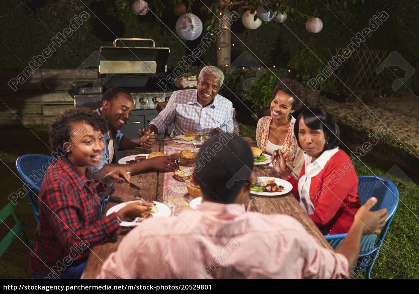 adult, black, family, talking, at, dinner - 20529801