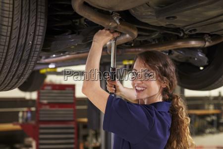 portrait of female auto mechanic working