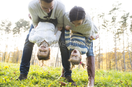playful family with two girls on