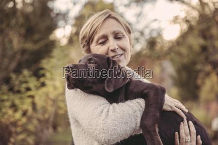woman holding labrador retriever