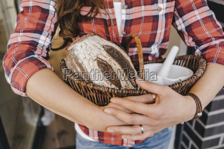 woman holding bread and salt as