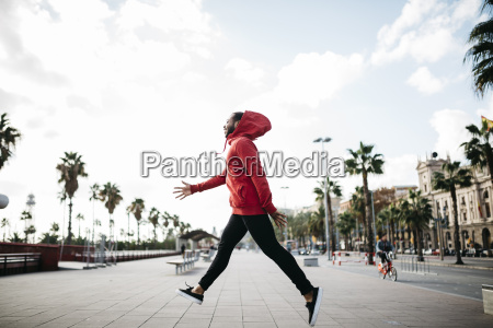 young man in the city jumping