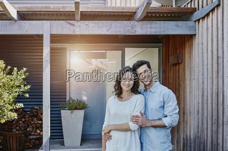 couple standing in front of door