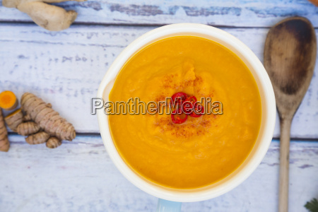 bowl of carrot curcuma soup with