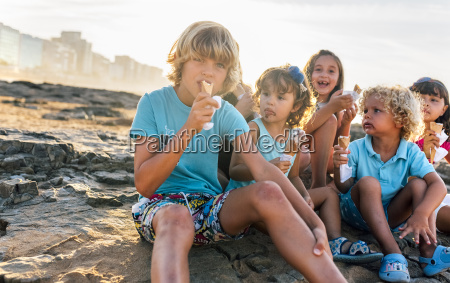 group of six children eating icecream