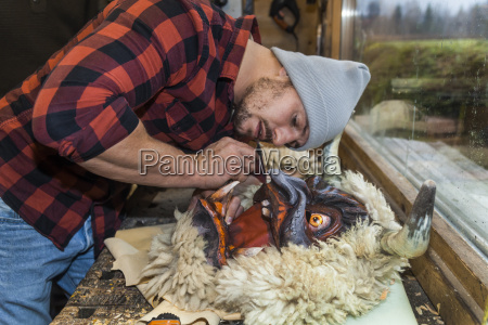 wood carver manufacturing traditional krampus mask
